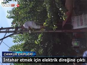 İntihar etmek için elektrik direğine çıktı